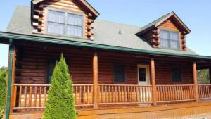 Paint Medics, Inc - Working on a log cabin refinishing project in Northeast Ohio